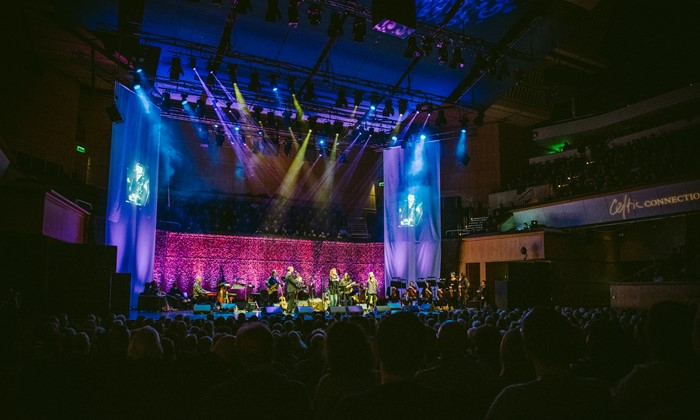 Grace and Danger band on stage at Glasgow Royal Concert hall with large audience